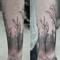 Simple black ink arm tattoo of dark forest with trees
