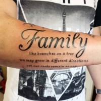 Simple black ink family dedicated lettering tattoo on arm