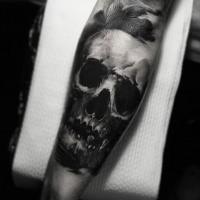 Simple black ink forearm tattoo of human skull