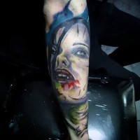 Simple designed colored bloody vampire woman tattoo on arm
