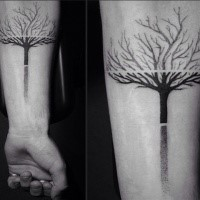 Simple dotwork style forearm tattoo of cool tree