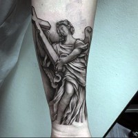 Simple homemade black ink angel tattoo with cross on forearm