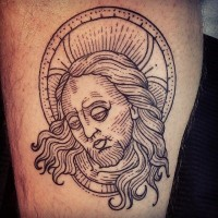 Simple homemade like black in sad Jesus tattoo