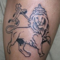 Simple homemade like black ink lion with crown tattoo