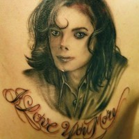 Simple homemade like Michael Jackson memorial portrait with lettering tattoo on shoulder