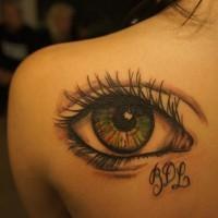 semplice fatto di casa stilizzato colorato grande occhio tatuaggio su spalla