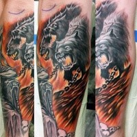 Simple illustrative style arm tattoo of Cerberus with chain and flames