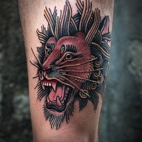 Simple illustrative style thigh tattoo of roaring lion