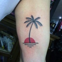 Simple little black ink palm tree with sun tattoo on arm