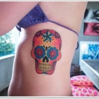 Simple mexican skull tattoo on ribs