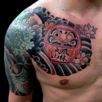 Simple old school style chest tattoo of daruma doll with flowers and waves
