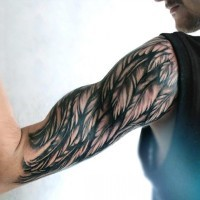 Simple painted black and white wing tattoo on sleeve