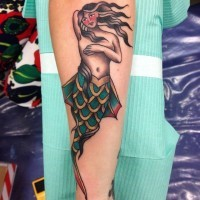 Simple painted old school style forearm tattoo of mermaid