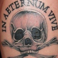 Simple pirate style black ink skull with bones tattoo combined with lettering