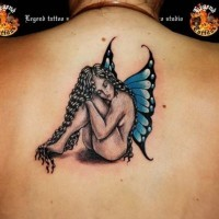 Sitting fairy with long black hair tattoo on back
