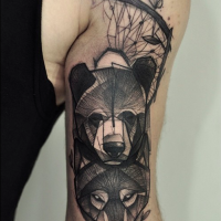 Sketch style black ink arm tattoo of bear and wolf head with tree
