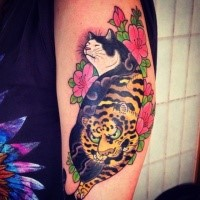 Sketch style black ink Manmon cat tattoo on arm