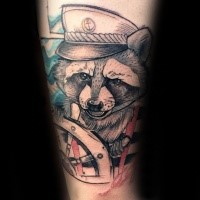 Sketch style colored arm tattoo of raccoon sailor