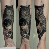 Sketch style colored forearm tattoo of big owl stylized with house and moon
