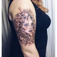 Sketch style colored shoulder tattoo of woman with jewelry and crown