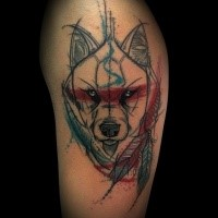 Sketch style colored upper arm tattoo of wolf with feather totem