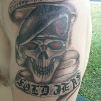 Skull in a military beret tattoo on arm