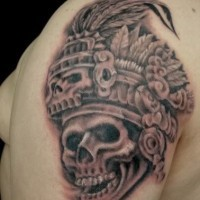 Skull in headdress priest aztec tattoo on shoulder