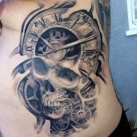 Skull tattoo and clock mechanisms tattoo on ribs by Josh Duffy.