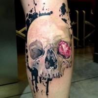 Skull with a pink diamond in orbit tattoo