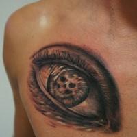Un œil avec le crâne le tatouage par graynd