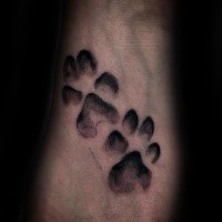Small black ink animal paw prints