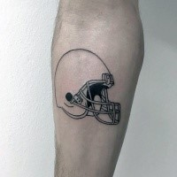 Small black ink forearm tattoo of sports game helmet