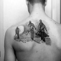 Small black ink scapular tattoo of