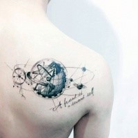 Small black ink scapular tattoo of various planets and lettering