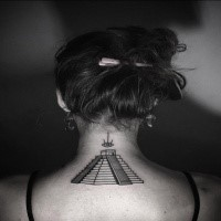 Small black ink upper back tattoo of Mayan pyramid