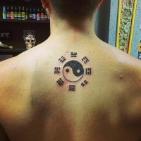 Small black ink Yin Yang symbol tattoo of back