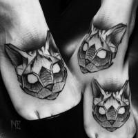 Small blackwork style foot tattoo of cat head by Inez Janiak