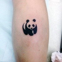 Small blackwork style leg tattoo of small panda bear