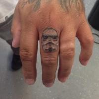 Small cartoon like colored finger tattoo of Storm troopers helmet