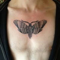 Small cartoon style chest tattoo of little butterfly