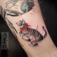 Small cartoon style tattoo of maneki neko japanese lucky cat