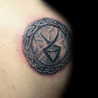 Small Celtic style detailed tattoo of small circle shaped tablet