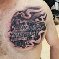 Small chest tattoo of steam train