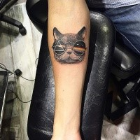 Small colored forearm tattoo of funny cat with sunglasses