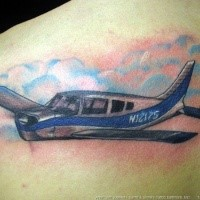 Small colored scapular tattoo of flying plane