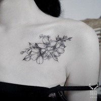 Small cute blackwork style collarbone tattoo of flowers by Zihwa