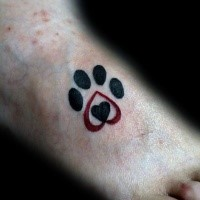 Small cute looking foot tattoo of animal paw print