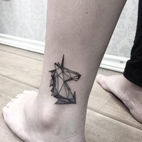 Small dot style ankle tattoo of cute unicorn