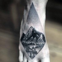 Small dot style black ink foot tattoo of beautiful mountain view
