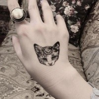 Small for girls like black and white hand tattoo of fantasy cat with moon symbol